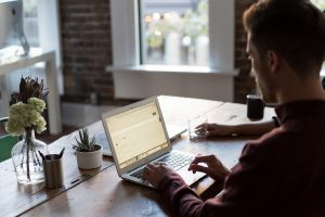 man-using-laptop-online-office