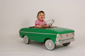 very-young-kid-driver-in-his-infant-car