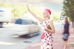 pretty-woman-flagging-down-a-taxi